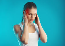 Woman suffering from headache. Depressed young woman having tinnitus and dizziness. Concept of stress, sickness and mind problem Stock Photography