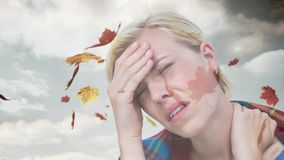 Woman suffering from headache and falling autumn leaves stock video