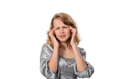 Woman suffering from a headache grimacing and holding her hands to her ears Stock Photography
