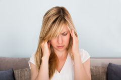 Woman Suffering From Headache At Home Stock Photos