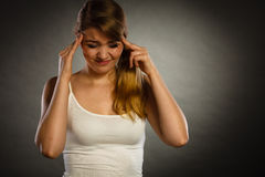 Woman suffering from headache migraine pain. Stock Photo