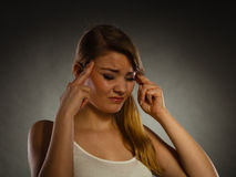 Woman suffering from headache migraine pain. Royalty Free Stock Image