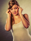 Woman suffering from headache migraine pain. Stock Image