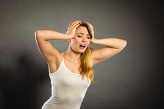 Woman suffering from headache migraine pain. Health problem, stress and depression. Woman suffering from headache migraine pain. Stressed female holds her head Stock Photography