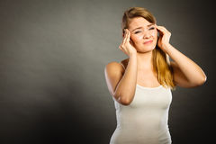 Woman suffering from headache migraine pain. Health problem, stress and depression. Woman suffering from headache migraine pain. Stressed female holds her head Royalty Free Stock Image