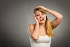 Woman suffering from headache migraine pain. Health problem, stress and depression. Woman suffering from headache migraine pain. Stressed female holds her head Royalty Free Stock Photography