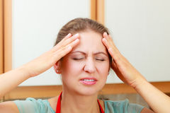 Woman suffering from headache migraine pain. Royalty Free Stock Photography