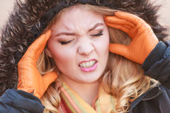 Woman suffering from headache pain. Cold. Stock Photos