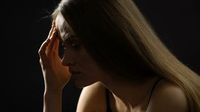Woman suffering headache and rubbing forehead, hormonal disorder, hard choice. Stock footage stock video