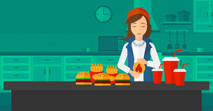 Woman suffering from heartburn. A woman standing in the kitchen in front of table full of junk food and suffering from heartburn vector flat design illustration Royalty Free Stock Photography