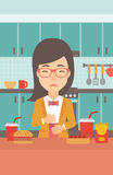 Woman suffering from heartburn. A woman standing in the kitchen in front of table full of junk food and suffering from heartburn vector flat design illustration Royalty Free Stock Image