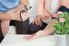 Woman suffering for hypertension Royalty Free Stock Photos