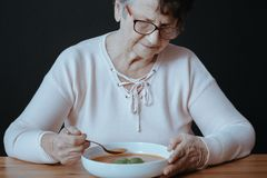 Woman suffering from inappetence Stock Photos