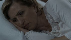 Woman suffering from insomnia because of stress, female health, menopause. Stock footage stock footage