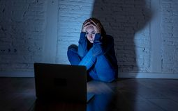 Woman suffering Internet cyber bullying. Sad and scared female Young woman with computer laptop suffering cyberbullying and harassment being online abused by Stock Photos