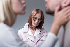 Woman suffering from motherly love Stock Photos