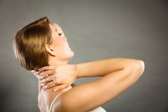 Woman suffering from neck pain Royalty Free Stock Images