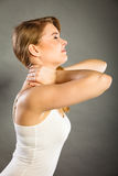 Woman suffering from neck pain Royalty Free Stock Photo