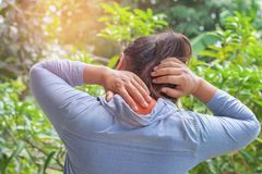 woman suffering from neck pain at outdoor. healthy stock photo