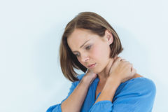 Woman suffering from neck pain Stock Photography