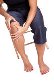 Woman suffering from pain on her knee Stock Image