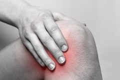 Woman suffering from pain in knee stock photo