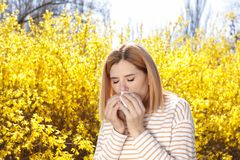 Woman suffering from seasonal allergy outdoors royalty free stock photos