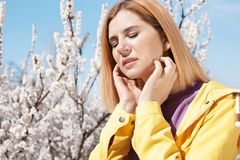 Woman suffering from seasonal allergy outdoors royalty free stock photo