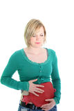 Woman suffering from a stomach ache Royalty Free Stock Photos