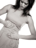 Woman suffering from stomach ache abdominal pain. Stock Photo