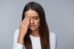 Woman Suffering From Strong Pain, Having Headache, Touching Face. Pain. Tired Exhausted Stressed Woman Suffering From Strong Eye Pain. Portrait Of Beautiful Stock Photography