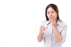Woman suffering from tooth sensitivity. White isolated background Royalty Free Stock Photos
