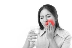 Woman suffering from tooth sensitivity. White isolated background Stock Images