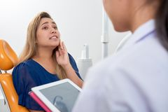Woman suffering from toothache stock photo