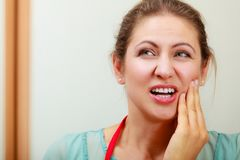 Woman suffering from toothache tooth pain. Mature woman female suffering from toothache tooth pain stock images