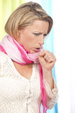 Woman suffers from coughing Royalty Free Stock Image
