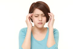 Woman suffers from headache Royalty Free Stock Image