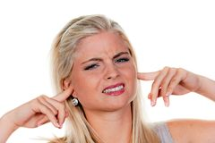 Woman suffers from noise pollution Royalty Free Stock Photos