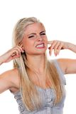 Woman suffers from noise pollution,. Young woman suffers from noise pollution, keep their ears stock images