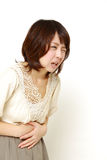 Woman suffers from stomachache Royalty Free Stock Photo