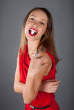 Woman with sugar in mouth Stock Image