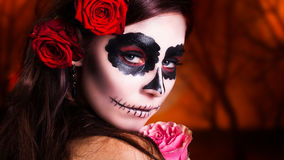 Woman with sugar skull make-up royalty free stock images