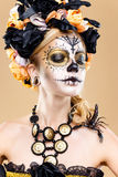 Woman with sugar skull makeup. Attractive young woman with sugar skull makeup,Dia de los Muertos - Mexican Day of the dead woman wearing sugar skull makeup and royalty free stock photo