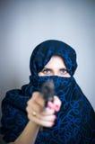 Woman suicide shoots a gun Stock Photo