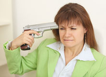 Woman suicide shoots itself at head from pistol Royalty Free Stock Image