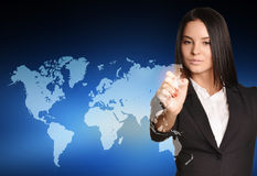 Woman in suit drawing on world map virtual space Stock Photo