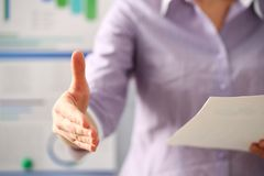 Woman in suit give hand as hello in office closeup stock image