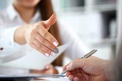 Woman in suit give hand as hello in office closeup royalty free stock photography
