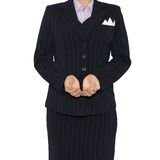 Woman in suit holding his hands before him Stock Photo