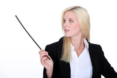 Woman in suit holding stick Royalty Free Stock Image